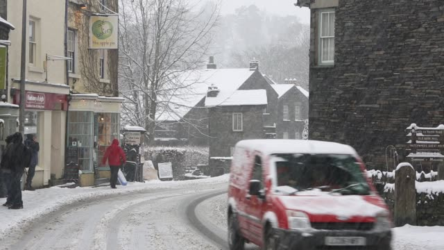 cars driving through snow in ambleside in the lake district at christmas uk - snowing stock videos & royalty-free footage