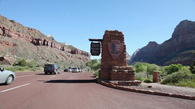 ws pan cars entering in national park/ zion national park, utah, united states  - zion national park stock videos & royalty-free footage