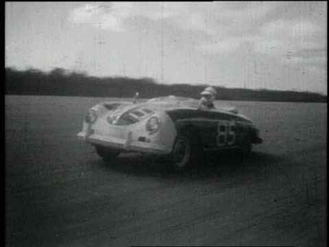 1957 montage a car's eye view of the race track as drivers test their cars and the conditions / nassau, bahamas - 1957 bildbanksvideor och videomaterial från bakom kulisserna