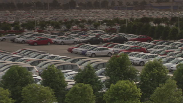 cars fill a parking lot at a ford plant in sichuan province, china. - ford motor company stock videos & royalty-free footage