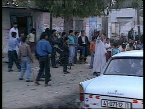 cars full of palestinian deportees are greeted by supporters at side of road gaza march 1994 - gaza strip stock videos & royalty-free footage