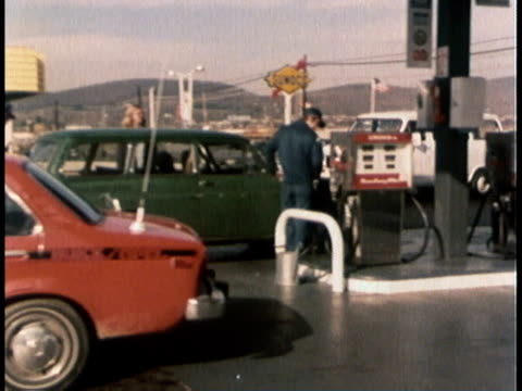 1978 MONTAGE Cars gassing up at gas tanks, weight and measures inspector driving up and getting out of van / United States
