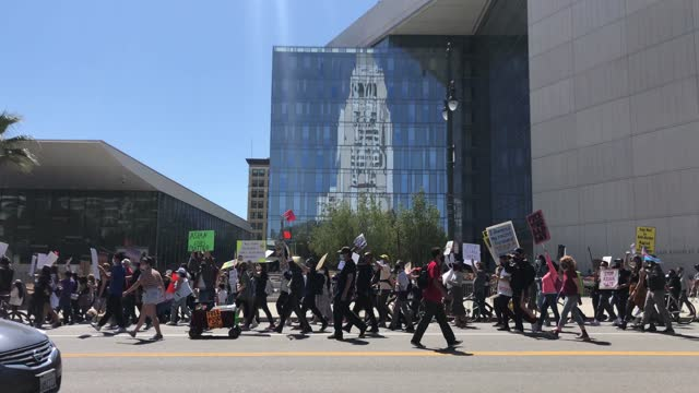 cars honk passing by a large crowd of people marching with signs against anti-asian violence and racism through downtown on march 27, 2021 in los... - asian and indian ethnicities stock videos & royalty-free footage