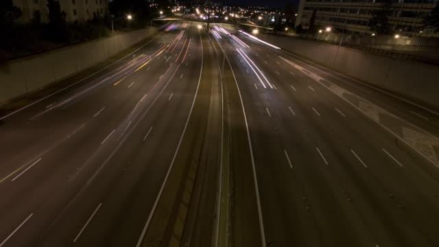 WS T/L ZI Cars in motion on street at night / Perth, Western Australia, Australia