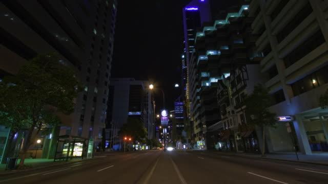WS T/L TD Cars in motion on street at night / Perth, Western Australia, Australia
