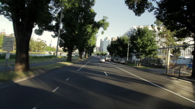 ms pov t/l  cars in motion towards downtown melbourne along with banks of yarra river / melbourne, victoria,  australia - car point of view stock videos & royalty-free footage