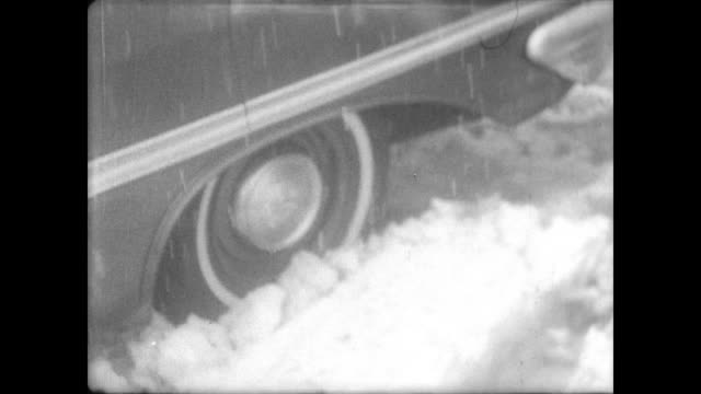 vídeos de stock e filmes b-roll de cars in traffic jam covered in snow and ice / cars stuck in the snow / cars pulled over to the side with people getting out trying to dig out from... - 1967