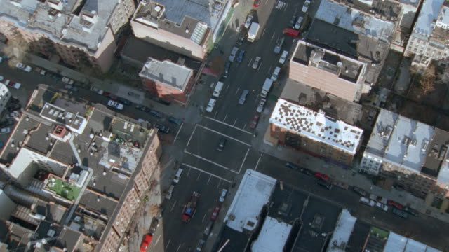 cars line a street between high-rises in new york city. - 2001 stock videos & royalty-free footage