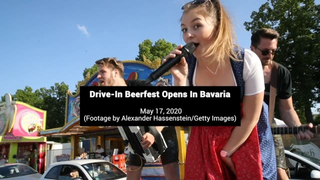 cars line up at a drive-in bavarian beerfest in erding, germany. bavaria's traditional volksfeste beer tent celebrations held throughout late spring... - german culture stock videos & royalty-free footage