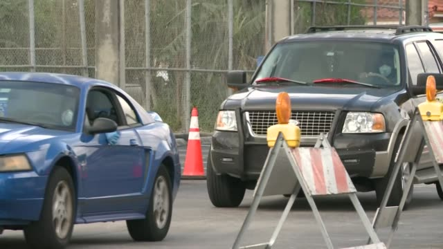 cars line up at an unemployment center in hialeah florida as the coronavirus craters the us economy - hialeah stock videos & royalty-free footage