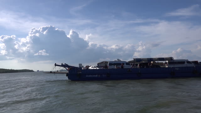 Cars loaded on a ferry and headed for the island Koh Lanta Krabi province of Thailand
