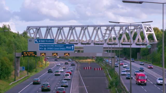 cars  lorries & railway bridge m60 motorway, manchester, england - motorway stock videos & royalty-free footage