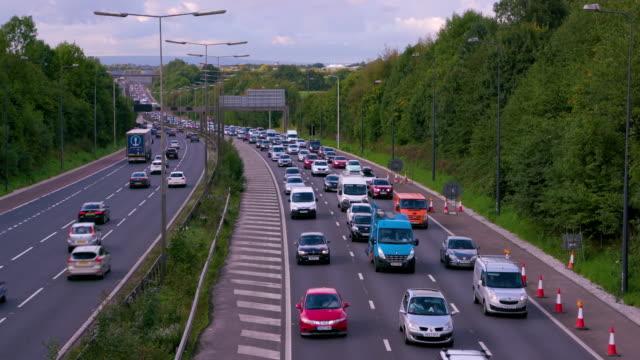 cars  lorries & vans m60 motorway, manchester, england - motorway stock videos & royalty-free footage