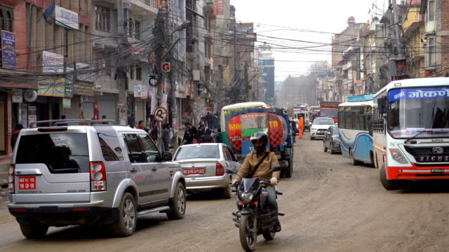 cars, motorcycles and buses and crowded streets in kathmandu, nepal capital city - kathmandu stock videos & royalty-free footage