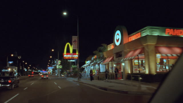 cars move along south figueroa street in los angeles at night. - tail light stock videos & royalty-free footage
