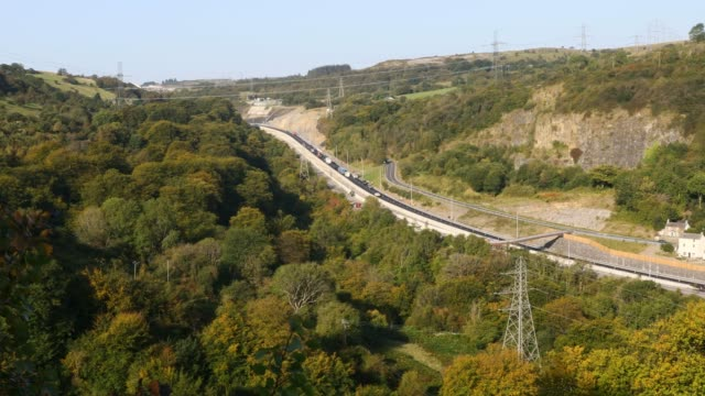 cars move along the a465 dual carriageway project named hov2 between brynmawr and gilwern on september 21, 2020 in clydach, abegavenny, wales, united... - major road stock-videos und b-roll-filmmaterial