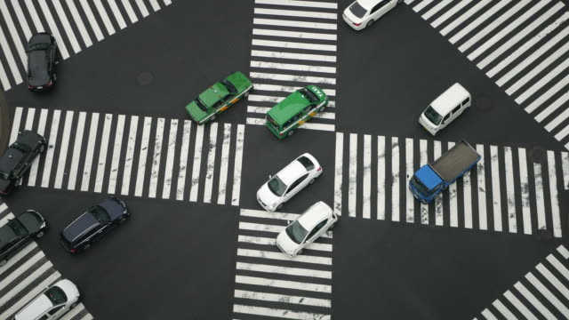 Cars moving across a busy street