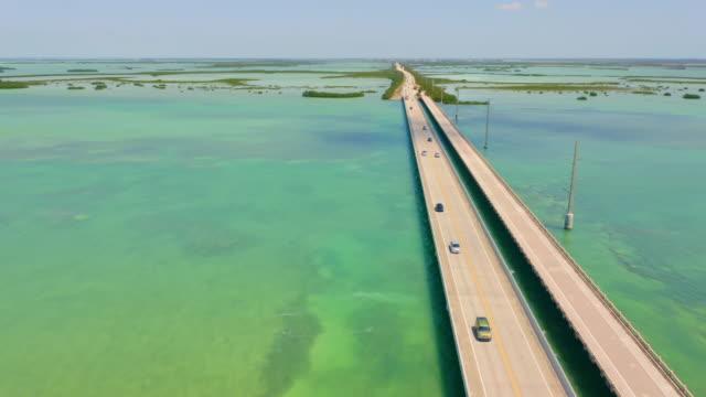 ws cars moving along seven mile bridge, florida keys, florida, usa - key west stock videos & royalty-free footage