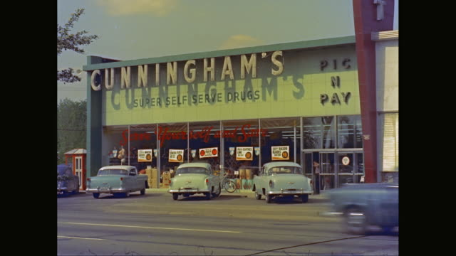 ws cars moving in front of shop/ united states - 1960 stock videos & royalty-free footage