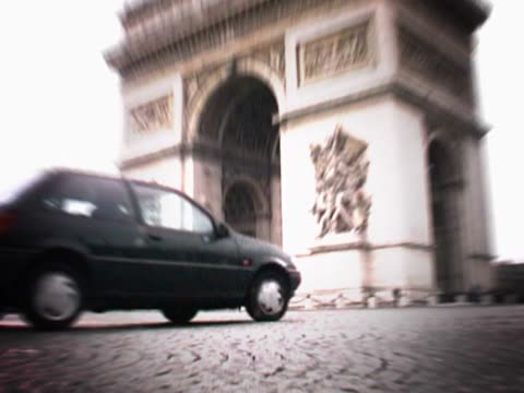 cars moving near an archway - unknown gender stock videos & royalty-free footage
