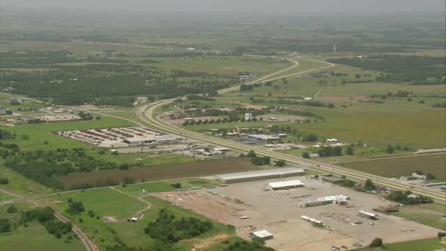 WS AERIAL Cars moving on freeway through suburbs area of city / Oklahoma, United States