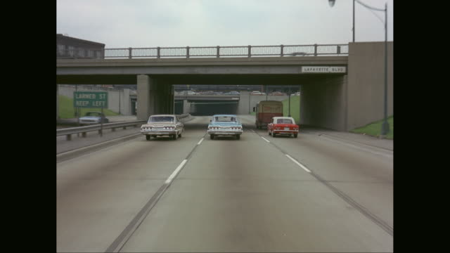 ws pov cars moving on highway with bridge / detroit, michigan, united states - vintage car stock videos and b-roll footage
