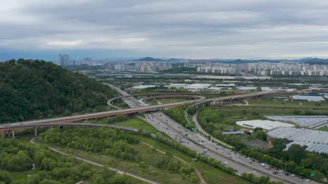 cars moving on incheon international airport expressway and jayu-ro highway / deogyang-gu, goyang-si, gyeonggi-do, south korea - traffic circle stock videos & royalty-free footage