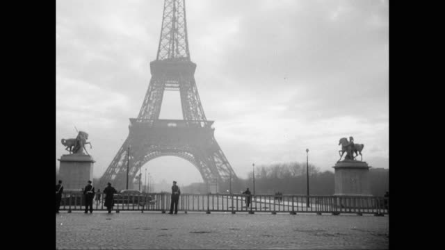ms cars moving on road, eiffel tower in background / paris, france - 1950 stock-videos und b-roll-filmmaterial