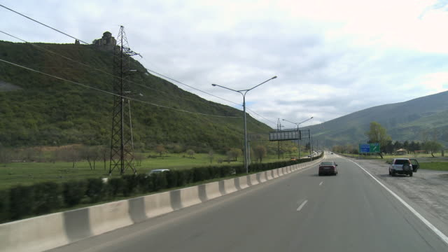 ms pov cars moving on road / mtskheta, georgia - caucasus stock videos and b-roll footage