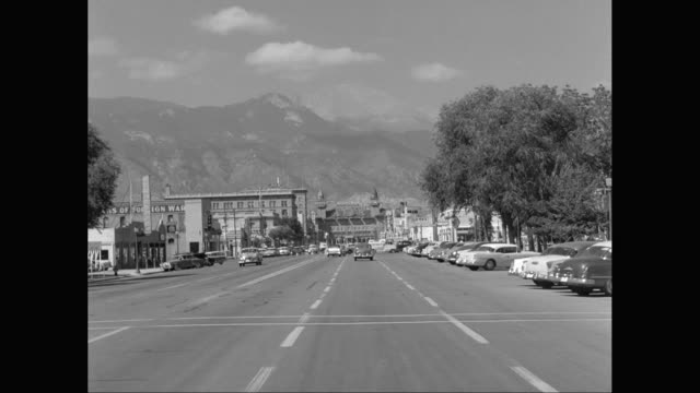 WS POV Cars moving on street toward the Antlers Hotel, Rocky Mountains /  Colorado Springs, Colorado, United States