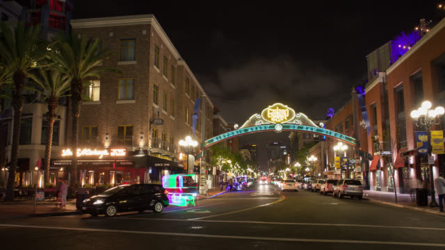 WS PAN T/L Cars moving on street with shop buildings at Gaslamp Quarter / San Diego, California, United States