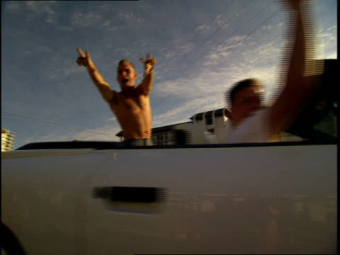 Cars of People Going to Florida Spring Break and Waving to the Camera