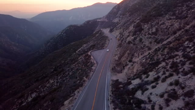cars on angeles crest highway, los angeles- aerial drone shot - cars in a row stock videos & royalty-free footage