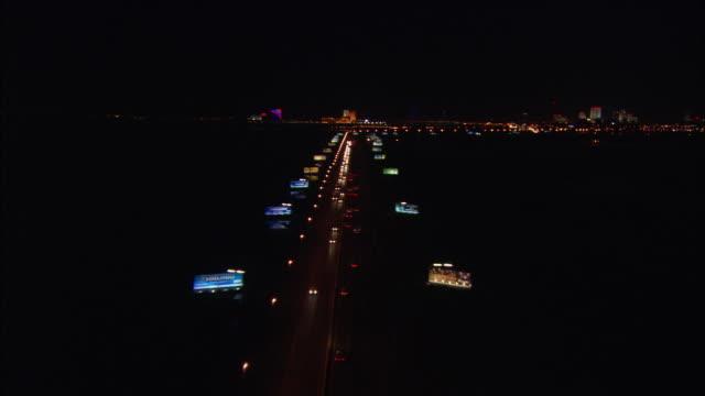 vídeos de stock, filmes e b-roll de aerial, cars on bridge at night, atlantic city, new jersey, usa - atlantic city