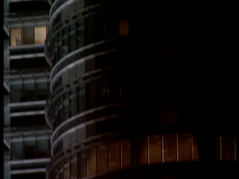 vidéos et rushes de cars on busy road at night tilt up along full height of petronas towers in kuala lumpur - impact