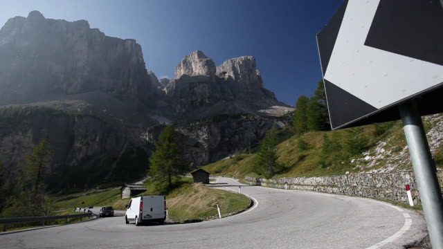 WS Cars on Gardena Pass with Sella Group in background / Alto Adige, Italy