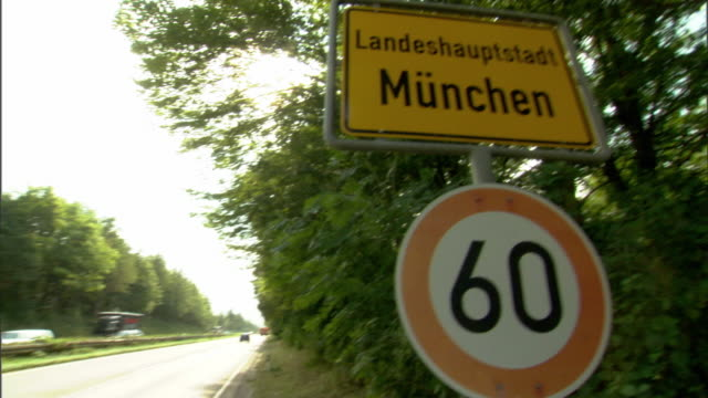 WS PAN MS Cars on highway and Munich city limits sign / Munich, Bavaria, Germany