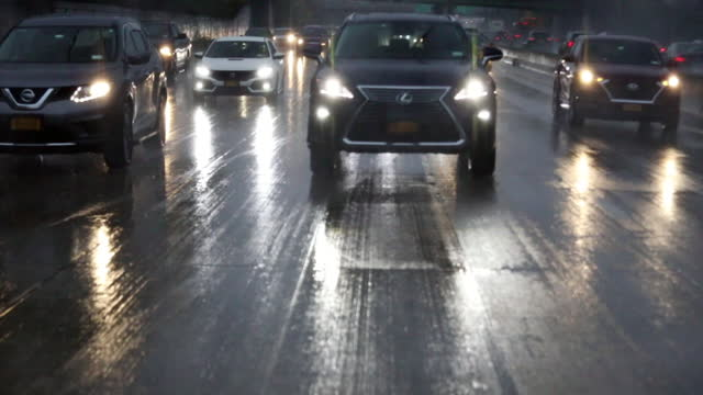 cars on highway during heavy rain. - headlight stock videos & royalty-free footage