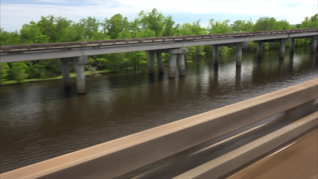 cars on i-10 freeway built over louisiana swamp land - bridge built structure stock videos & royalty-free footage