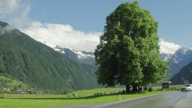 ws cars on road with austrian landscape in background / mayrhofen, zillertal, austria - north tirol stock videos & royalty-free footage