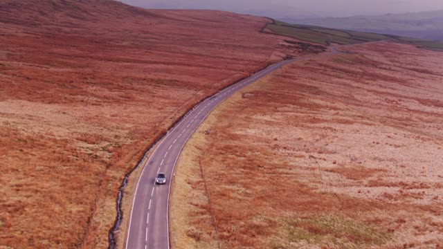 cars on winding country road between oxenhope and hebden bridge, england - drone shot - pennines stock videos and b-roll footage