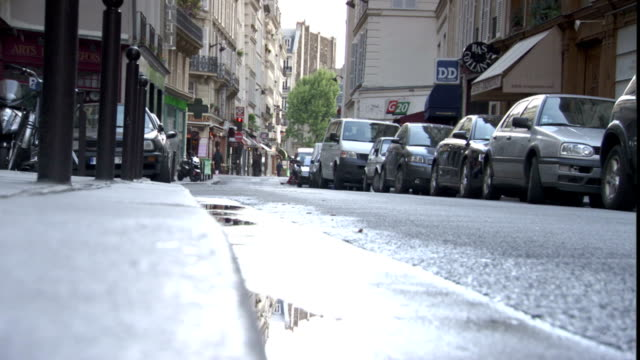 cars park along a narrow, wet street. - parking stock videos & royalty-free footage