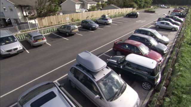 cars park in a town parking lot. - parking stock videos & royalty-free footage