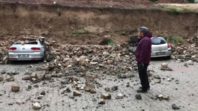 Cars parked at a parking lot of a residential building were damaged when a retaining wall collapsed after a heavy rainfall in Cukurova district of...