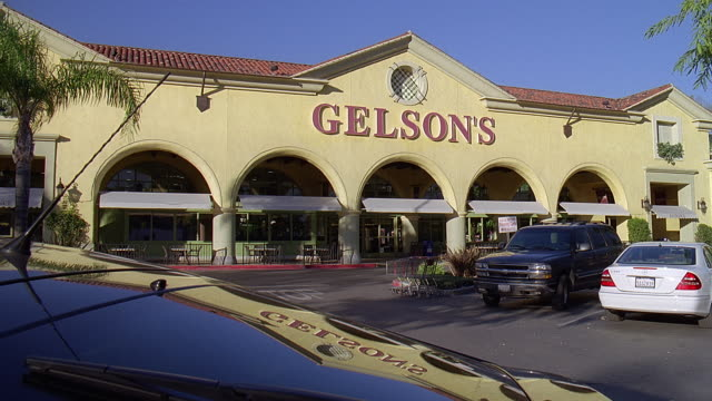 ws cars parked in front of gelson's supermarket / paramount, california, usa - paramount pictures stock videos & royalty-free footage