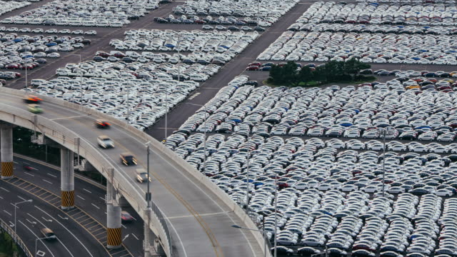 Cars parked on quayside for exporting from the docks.