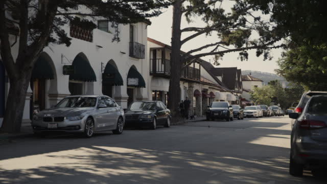 cars parked on quiet city street / carmel, california, united states - carmel california stock videos & royalty-free footage