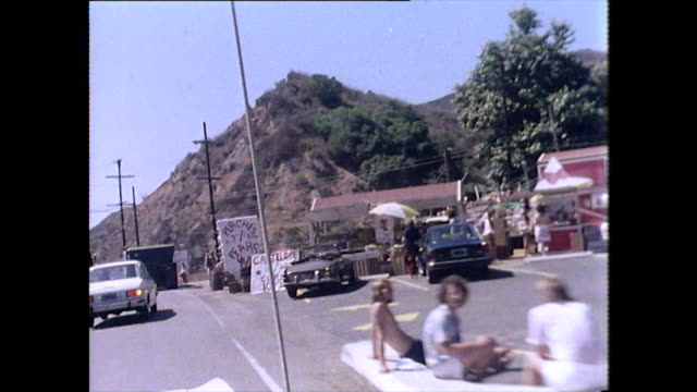 cars pass a rest stop selling fruit; san francisco, 1976 - brown stock videos & royalty-free footage