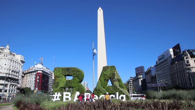 cars pass and people take photos at the obelisk monument on 9 de julio avenue on may 11, 2021 in buenos aires, argentina. - avenida 9 de julio video stock e b–roll