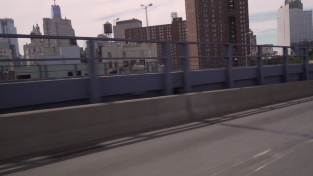Cars pass by while exiting the Manhattan Bridge into Manhattan.